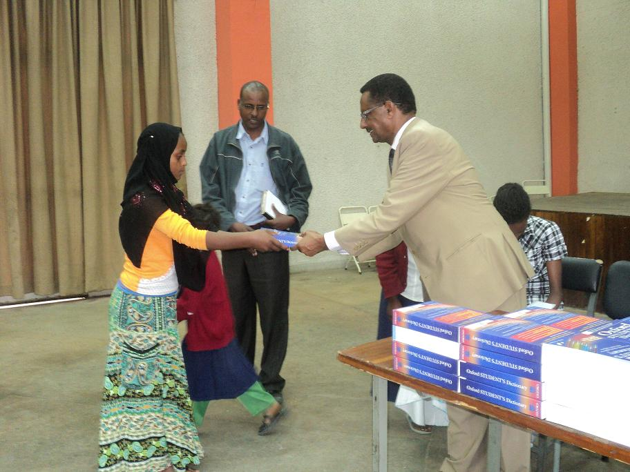 Ato Getachew Tessema, Representative Of Kinderhaus Addis While Handing Over The Dictionary To The Sponsored Children